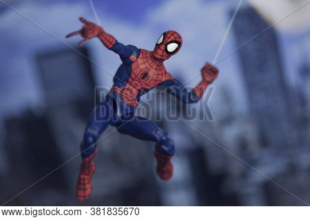AUGUST 21 2020: Spiderman from Marvel Comics and The Avengers swinging from a web - Hasbro action figure