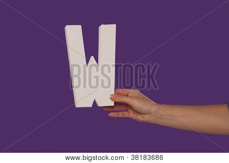 Female Hand Holding Up The Letter W From The Right