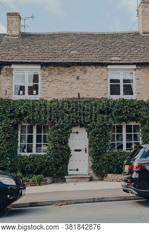 Stow-on-the-wold, Uk - July 10, 2020: Front Of A House, Partially Covered With Wall Climbing Plants