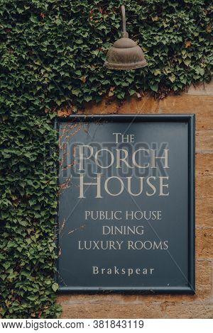 Stow-on-the-wold, Uk - July 10, 2020: Wall Sign On Front Of The Porch House, The Oldest Inn And Pub