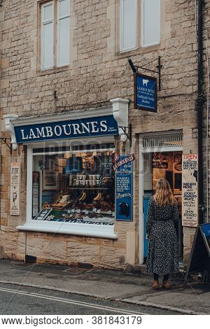 Stow-on-the-wold, Uk - July 10, 2020: Woman Standing On A Street, Waiting To Enter Lambournes Butche