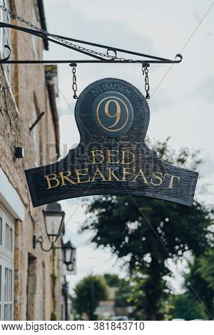 Stow-on-the-wold, Uk - July 10, 2020: Hanging Sign Outside Number Nine Bed & Breakfast In Stow-on-th