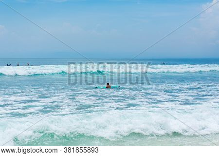 The Guy Is Swimming On The Surf Board On The Ocean. Healthy Active Lifestyle In Summer Vocation