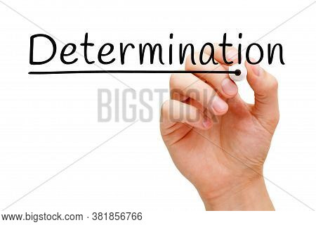 Hand Writing The Word Determination With Black Marker On Transparent Wipe Board.