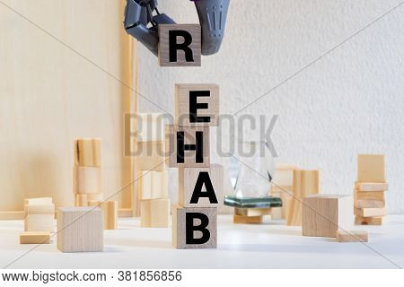 The Word Rehab Written In Dirty Vintage Letterpress Type On A Aged Wooden Background