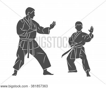 Trainer With A Young Boy In Kimono Training Karate On A White Background