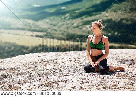 Contemplation. Yoga Time. Sport. Woman Sitting On Mountain. Enjoying Virgin Nature Landscape. Green
