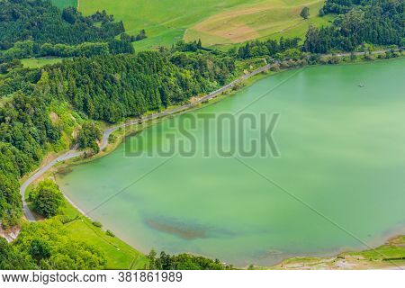 View of the Lake Furnas (Lagoa das Furnas) on Sao Miguel Island, Azores, Portugal from the Pico do Ferro scenic viewpoint. Tranquil scene of the lake in a volcanic crater