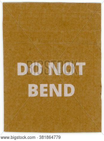 Do Not Bend Written On Brown Corrugated Cardboard Packet