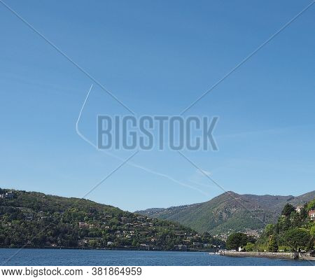 Blue Sky With Plane Vapour Trails (aka Contrails, Short For Condensation Trails)