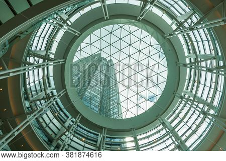 Oklahoma City Usa - September 9 2015; View Through Glass And Steel Circular Dome To High-rise Office