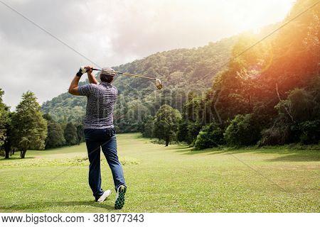 Professional Golfer Taking A Shot. Bali. Indonesia.