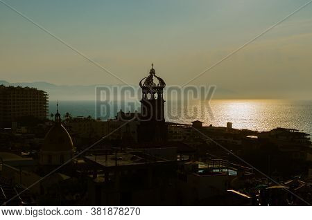 Beautiful Sunset In Puerto Vallarta, View Of The Cathedral Against The Light.