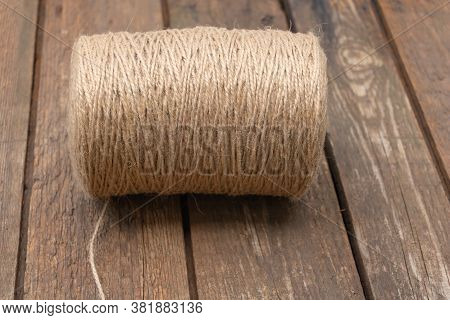 A Roll Of Brown Coir Rope On Wooden Backgroud. Used In Gardening