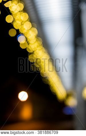 Festive Christmas Gold Background. Golden Holiday Glowing Backdrop. Defocused Background With Blinki