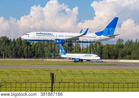 Saint Petersburg, Russia - August 08, 2020: Two Boeing 737  Of Pobeda Airlines On The Pulkovo Airpor