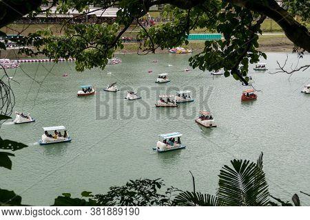 Unidentified People Enjoying Pedal Boats At Bitan Scenic Area