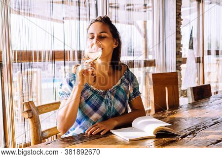 Woman Drinking Wine At Wine Bar In Vacation. Woman Relaxing In Wine Bar In Vacation. Vacation Lifest