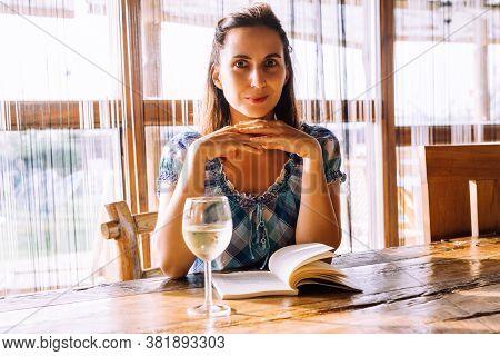 Beautiful woman portrait with wine. Beauty Woman face Portrait. Beautiful model woman portrait. Stylish woman portrait with glass of wine. Beautiful woman portrait. Woman fashion portrait. Woman drinking wine. Woman portrait in restaurant. Wine restaurant