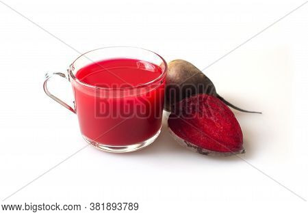 Beet Juice. Fresh Beetroot In A Glass On A White Background Of Isolate. Close Up. Fresh-squeezed Jui