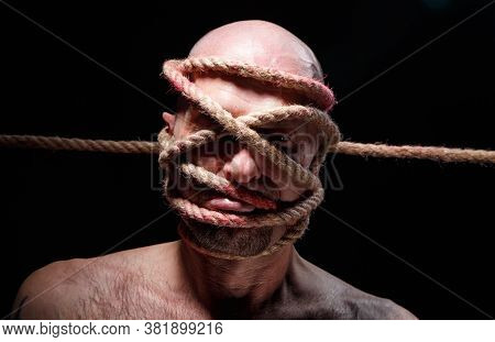 Image Of Binded Adult Man With Rope On Face