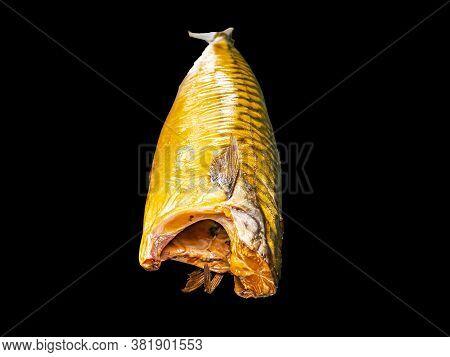 Smoked Mackerel Fish On A Black Background. Salted Mackerel Fish. Canned Food. Food Photo. Recipe. M