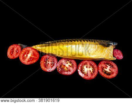 Smoked Fish Mackerel And Tomatoes On A Black Background. Salted Mackerel Fish. Canned Food. Food Pho