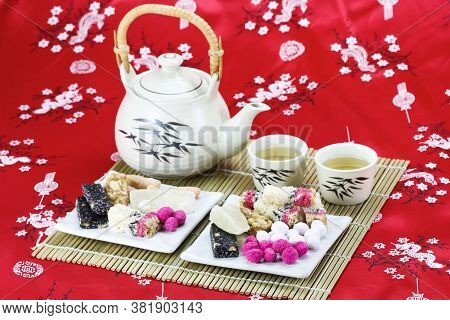 Chinese   Traditional Snacks With Tea On Red Table