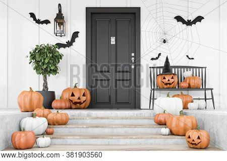 Carved Pumpkins, Bats And Spiders On Stairs And Bench Near Modern House With Black Front Door, Tree