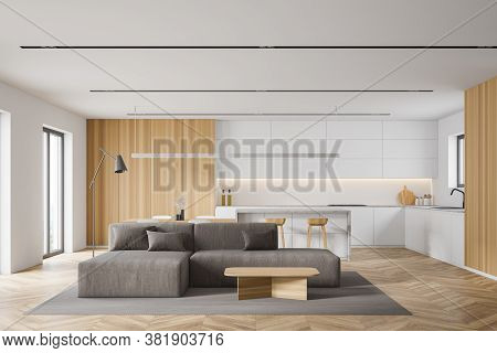Interior Of Modern Living Room With White And Wooden Walls, Wooden Floor, Comfortable Sofa Near Coff