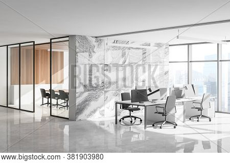 Corner Of Stylish Open Space Office With Panoramic Window, White Marble Walls And Rows Of Computer T
