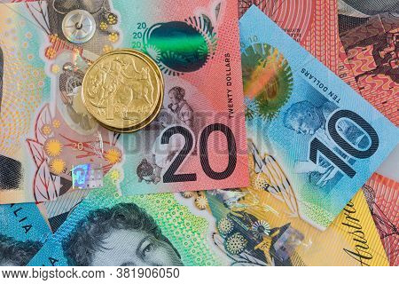 Closeup Of Australan Money Including Ten And Twenty Dollar Notes And One Dollar Coin.
