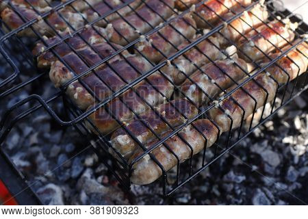 Sausages Are Grilled On The Grill. B-b-q. Grilling Meat. Barbecue Grilling Sausages. Outdoor Cooking