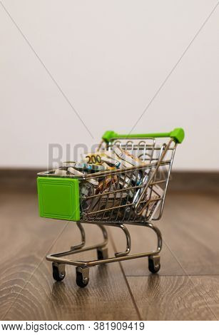 Mini Basket Filled With Sweets In The Form Of Money. Money Basket. Small Cart Full Of Money. The Car