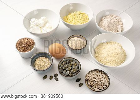 Ingredients For A Protein Bread With Quark, Oat Bran, Lupine Flour, Almond And Various Seeds In Bowl