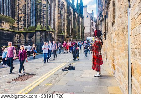 Bagpipe Player On Ancient Royal Mile. Medieval Old Town Edinburgh, Scotland, Uk