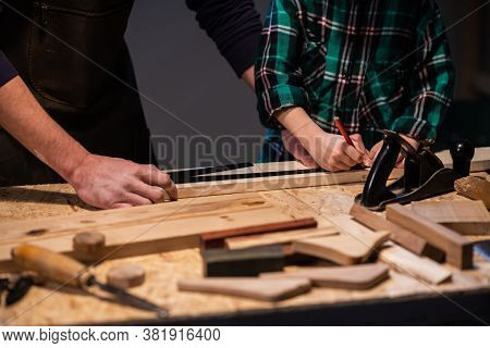 Close-up Of The Work Of A Man And A Boy At A Carpenters Table, On The Table Are A Plane, Chisel, Boa