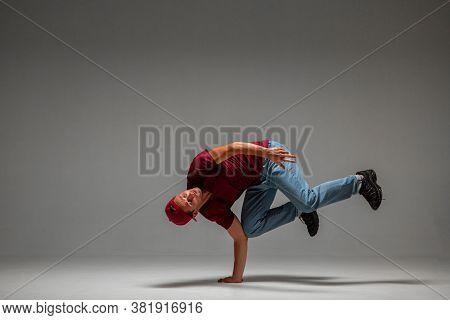 Cool Guy Breakdancer Dancing Lower Break Dance On The Floor Isolated On Gray Background. Break Dance