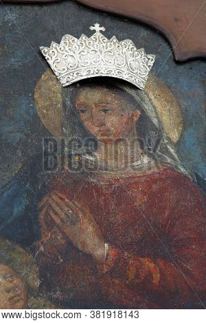 NOVALJA, CROATIA - SEPTEMBER 29, 2013: Virgin Mary with child Jesus, altarpiece at St. Mary's Church in Novalja, Croatia