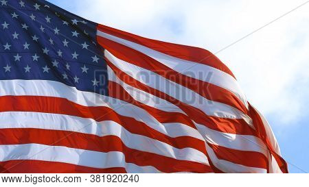 American Flag Waving Proudly In The Wind, Representing. United States Of America On A Sunny Day. Usa