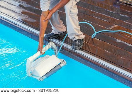 African Pool Cleaner During His Work. Cleaning Robot For Cleaning The Botton Of Swimming Pools. Auto