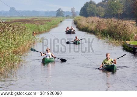 Weerribben, The Netherlands- September 03, 2011: People Pedaling In Canoes Through Wetlands Of Dutch