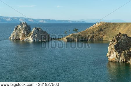 Beautiful Landscape Of Siberian Baikal Lake. Larch In The Foreground. Panoramic View Of Shamanka Roc