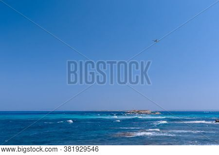 Seascape With Beautiful Blue Sea And White Waves In The Distance Lighthouse, Seaplane In The Air Fli