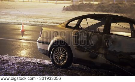 Car Accident. Wrecked And Burned Vehicle On The Road On The Coast. High Quality Photo
