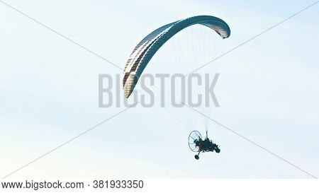Tandem Paramotor Gliding - Two Men Flying And Gliding In The Air. High Quality Photo