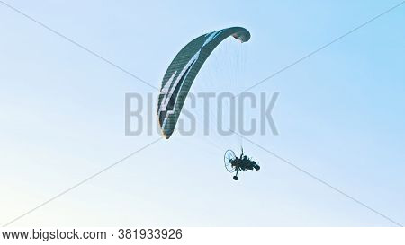 Paramotor Tandem Gliding And Flying In The Air. Copy Space. High Quality Photo