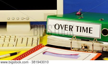 Over Time-a Text Label On The Office Registrar Folder. On The Desktop There Is A Monitor, Computer K