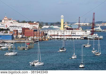 The Industrial View Of Nassau Harbour Full Of Drifting Sailboats (nassau, Bahamas).