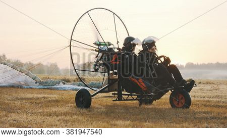 Paramotorgliding. Successfully Landed, Glider Untying Parachutist. High Quality Photo